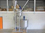 Mixing installation for liquids and powder